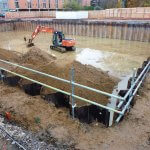 an image of a digger digging into wet ground