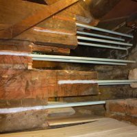 An image showing an attic that has undergone some piping work to help with stability and structural support