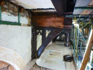An image showing the period features inside a building's attic where mould is present