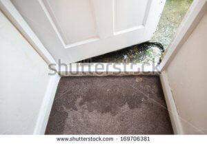 an image of flooding near a front door