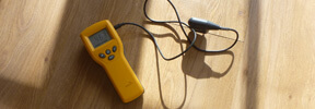 An image showing a damp detecting tool