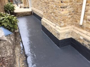 An image showing a garden pavement and wall that has been damp proofed