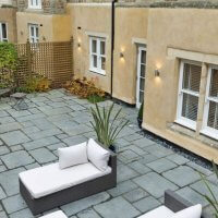 An image showing the exterior courtyard of a property