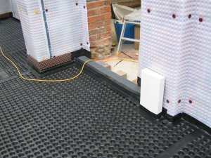 an image of a building interior being protected with a damp-proof material
