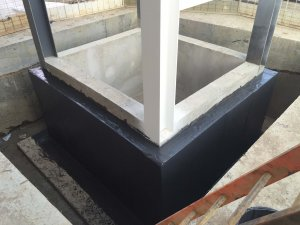 An image showing a cemented structure that has had damp proofing