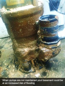 An image showing a badly damaged pump in a basement that will require pump servicing