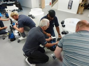 An image showing workers carrying out some pump servicing work in a room