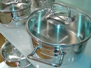 An image showing cooking pots with their lids on to prevent condensation