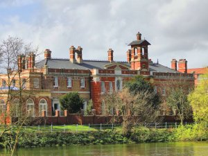 an image of Gordon House, a stately house on the bank of the Thames in Surrey