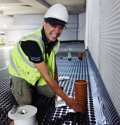 an image of a damp proofing installer smiling during a project